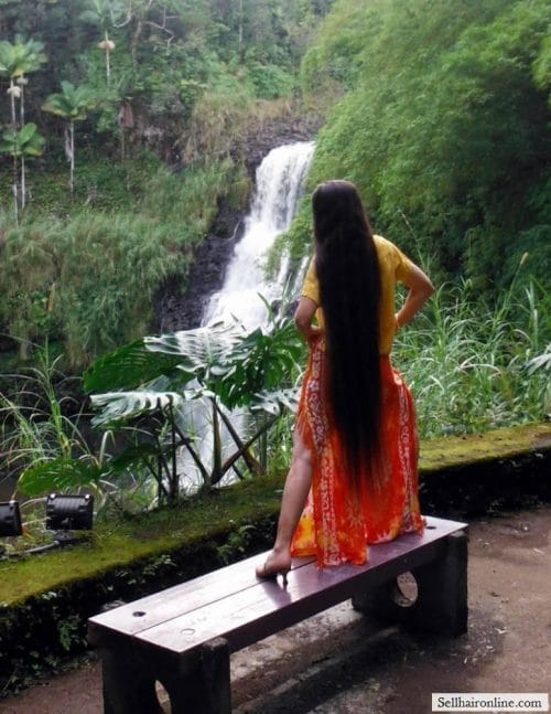 By the waterfall in Hawaii.