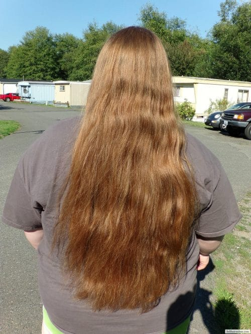 24 inches of thick virgin copper red hair